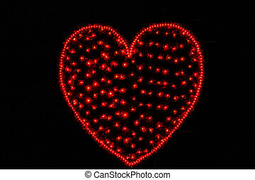 original red glowing heart on a black background