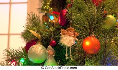 Beautiful ornaments hanging on Christmas tree. Beautifully...