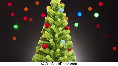 beautiful ornate christmas tree on a black background with lights