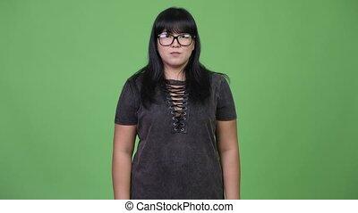 Beautiful overweight Asian woman with eyeglasses - Studio...