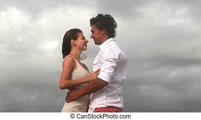 Beautiful pair - Happy attractive pair standing  on coast