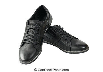 Beautiful pair of black mens sport shoes isolated on white...