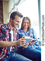 Beautiful pair - Smiling boy and girl looking at their...