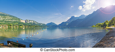 Beautiful panorama of lake Annecy, France. Popular summer vacation destination. Postcard from South of France
