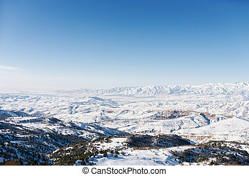 Beautiful panorama of the Tien Shan mountains in Uzbekistan in the Beldersay ski resort on a clear winter day