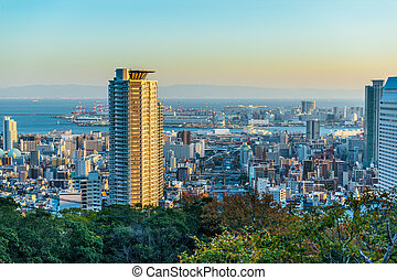 beautiful panoramic aerial view of sunset Kobe city with modern buildings and coastline, Japan
