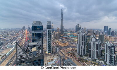 Beautiful panoramic skyline of Dubai day to night timelapse, United Arab Emirates. View of world famous skyscrapers.