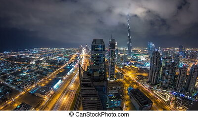 Beautiful panoramic skyline of Dubai night timelapse, United Arab Emirates. View of world famous skyscrapers.