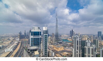 Beautiful panoramic skyline of Dubai timelapse, United Arab Emirates. View of world famous skyscrapers.