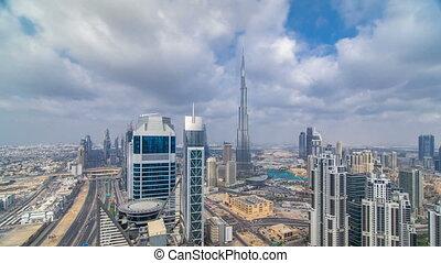 Beautiful panoramic skyline of Dubai timelapse, United Arab Emirates. View of world famous skyscrapers.
