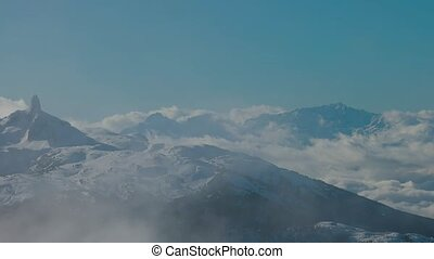 Beautiful View of Black Tusk and Canadian Nature Landscape covered in Snow during winter. Taken on top of Whistler Mountain, British Columbia, Canada. Nature Background. Slow Pan