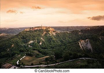 Beautiful panoramic view of famous Civita di Bagnoregio with Tiber valley at sunset, Lazio, Italy