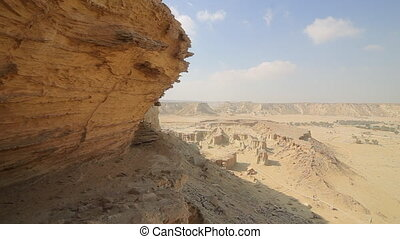 Beautiful panoramic view of the rocky desert mountains with valley in the distance. Hengam island. Iran