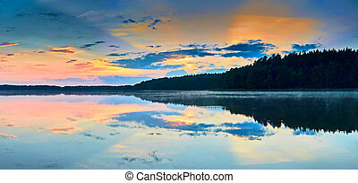 Beautiful panoramic view of the sunset over Lemiet lake in Mazury district, Poland. Fantastic travel destination.