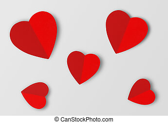 Beautiful paper hearts on grey paper background, close-up