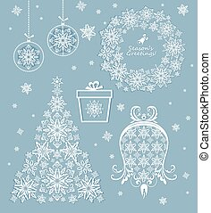 Beautiful paper xmas set with cut out christmas tree, bell, xmas wreath, giftbox, snowflakes and hanging balls