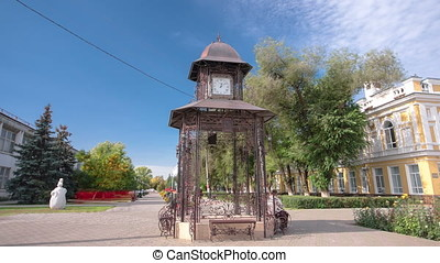 Beautiful park with clock on pavilion in the center of...