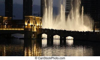 beautiful part of city with river, bridge and fountain at...