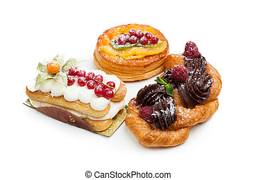 beautiful pastry cakes, isolated on white
