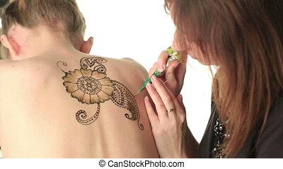 Beautiful pattern of henna on model's back - Mehandi....