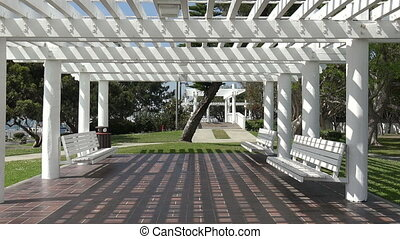 Beautiful pavilion in a park - Sunlight and shadows under a...