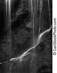 Beautiful peaceful black and white long exposure waterfall detail intimate landscape image