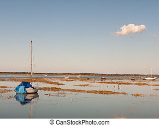 beautiful peaceful harbour scene estuary maldon boat mast reflections