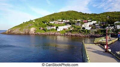 Beautiful Petty Harbour with two piers during summer sunset, Newfoundland, Canada