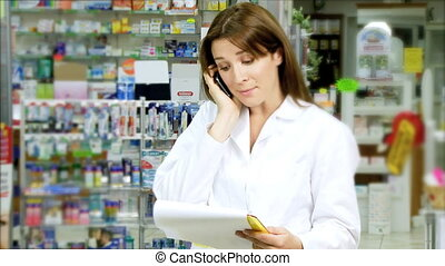 Beautiful pharmacist on the phone