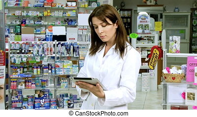 beautiful pharmacist working with t