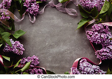 Beautiful photo of lilac in the air frame on black background with free space for your text