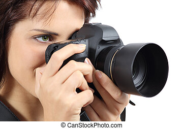 Beautiful photographer woman holding a digital camera isolated on a white background