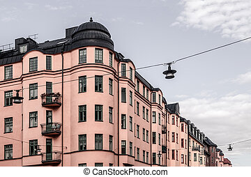 Beautiful pink building on cloudy sky background