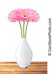 beautiful pink gerbera daisy flowers in vase on wooden table over white