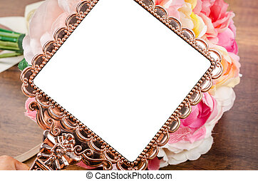 Beautiful pink gold mirror.