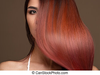 Beautiful pink-haired girl in move with a perfectly smooth hair, and classic make-up. Beauty face.