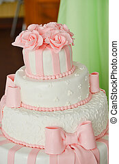 Beautiful pink luxury wedding cake on reception