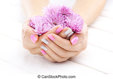 pink manicure with chrysanthemum flowers. spa