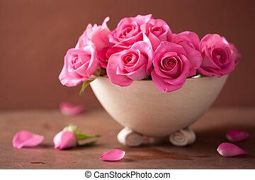 beautiful pink rose flowers in vase