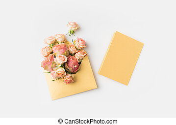 pink roses in envelope