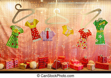 Beautiful pink storefront with gifts and colored paper clothing
