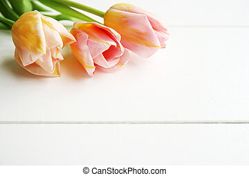 Beautiful pink tulips on wooden background, copy space