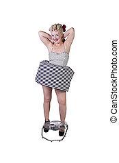 Beautiful pinup retro girl enjoying cool air from fan