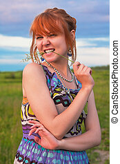 Beautiful playful ginger-haired woman