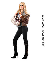 Beautiful playful young blonde with a handbag. Isolated