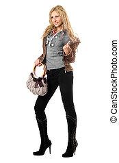 Beautiful playful young blonde with a handbag