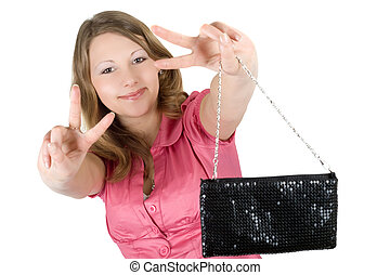 Beautiful playful young woman with a handbag. Isolated