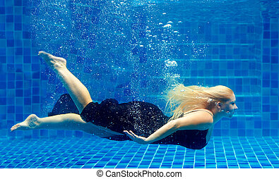 beautiful plus size woman diving in pool