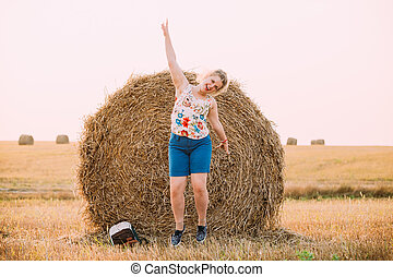 Beautiful Plus Size Young Woman Girl Jumping Near Haystack