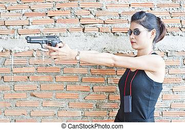 Beautiful policewoman in action. - Beautiful Asian...
